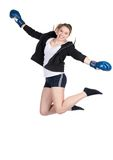 Young smiling female boxer is jumping Stock Photos