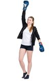 Young smiling female boxer in victory pose Royalty Free Stock Photo