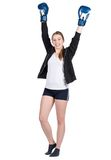 Young smiling female boxer in victory pose Royalty Free Stock Image