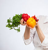 Young smiling female cook preparing salad Royalty Free Stock Photo