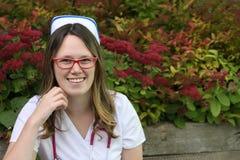Young nurse with cap Stock Photos
