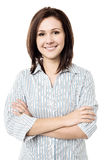 Young smiling female posing confidently Royalty Free Stock Images