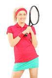 Young smiling female posing with a tennis racket Stock Photography