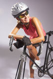 Young smiling female sportswoman with old school singlespeed rac Royalty Free Stock Image