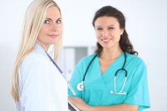 Young smiling female surgeon doctor standing at hospital. Medicine and health care concept.  Royalty Free Stock Photo