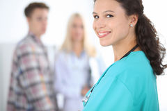Young smiling female surgeon doctor standing at hospital. Medicine and health care concept.  Stock Images