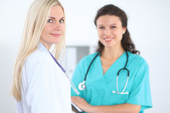 Young smiling female surgeon doctor standing at hospital. Medicine and health care concept.  Royalty Free Stock Photography