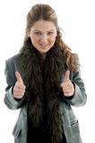 Young smiling female with thumbs up Royalty Free Stock Photography