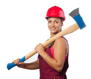 Young smiling female woodcutter with hard hat Royalty Free Stock Image