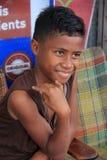 Young, smiling Fijian boy at outdoor market,Fiji,2015 stock image