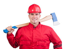 Young smiling fireman with hard hat and ax Stock Photos