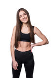Young smiling fitness-girl in sport style isolated on white background. Healthy lifestyle concept. Young smiling fitness-girl in sport style isolated on white stock photos