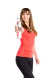 Young smiling fitness girl standing with bottle of water Stock Images