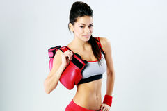 Young smiling fitness woman standing with boxing gloves Royalty Free Stock Photos