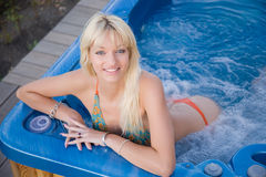 Young smiling girl. In Jacuzzi stock photography