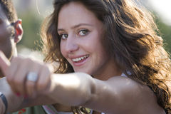 Young and smiling girl. Waving hands Royalty Free Stock Photo