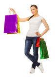 Young smiling girl with bags Stock Photos