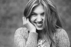 Young smiling girl - close up. Black & white Royalty Free Stock Photography