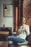 Young smiling girl with a cup of coffee Stock Image