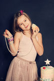 Young smiling girl with cupcake Stock Photo