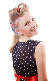 Young smiling girl in curlers  looking over her Stock Photography