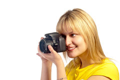 Young smiling girl with a dslr camera Stock Photos