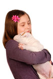 Young Smiling Girl Embraces White Bullterrier Puppy Stock Images