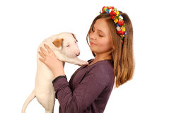 Young Smiling Girl Embraces White Bullterrier Puppy Stock Photography
