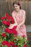 Young smiling girl florists working in the garden Stock Images