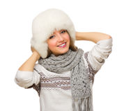 Young smiling girl with fur hat Stock Photo