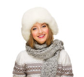 Young smiling girl with fur hat Royalty Free Stock Image