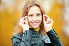 Young smiling girl in glasses Stock Images