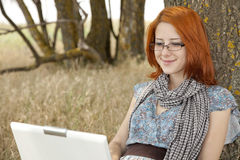 Young smiling girl in glasses and notebook Royalty Free Stock Photography