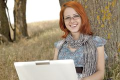 Young smiling girl in glasses and notebook Royalty Free Stock Images