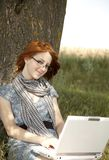 Young smiling girl in glasses and notebook Stock Photography