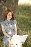 Young smiling girl in glasses and notebook Royalty Free Stock Photo