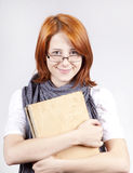 Young  smiling girl in glasses with old book Stock Photography