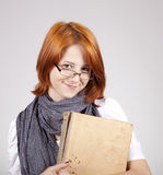 Young  smiling girl in glasses with old book Royalty Free Stock Photos