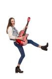 Young smiling girl with guitar isolated on white Stock Photo