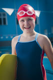 Young smiling girl having a head ache in the pool Stock Images