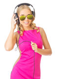 Young smiling girl with headphones. Isolated Royalty Free Stock Photo