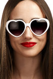 Young smiling girl with heart-shaped glasses Royalty Free Stock Image