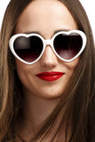 Young smiling girl with heart-shaped glasses Royalty Free Stock Photos