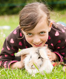 Young smiling girl with her rabbit pet Stock Photography