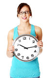 Young smiling girl holding a clock. Stock Image