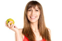 Young smiling girl holding green apple in hand. Fitness woman Stock Photo