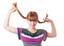 Young Smiling Girl Holding Plaits Stock Photography