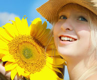 Young smiling girl holding sunflower in her hands Stock Images