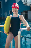 Young smiling girl learning to swim in the pool Royalty Free Stock Photography