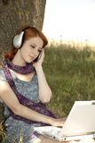 Young smiling girl with notebook and headphones Royalty Free Stock Images